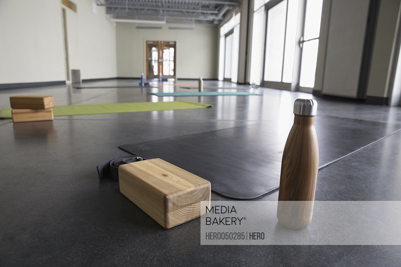 Water bottle box and yoga mat in yoga class gym studio