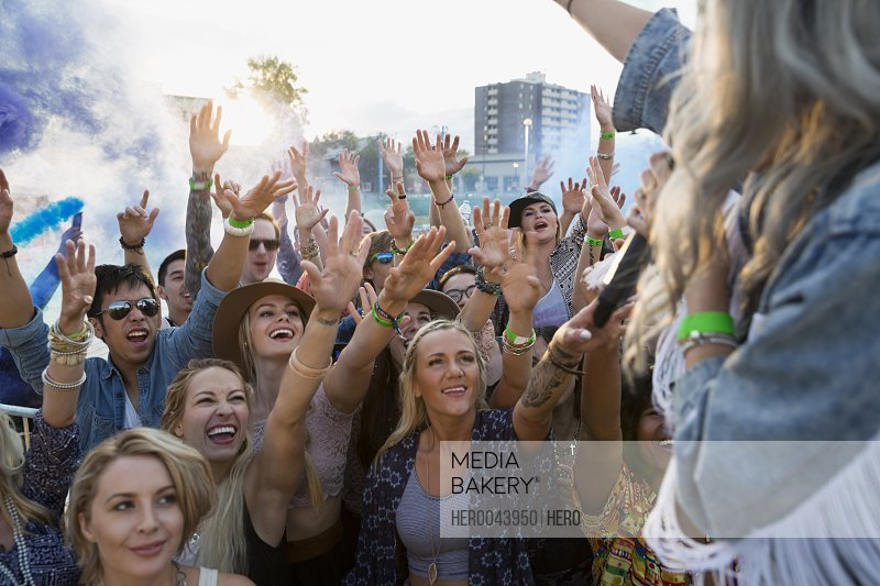 Musician waving to crowd at summer music festival