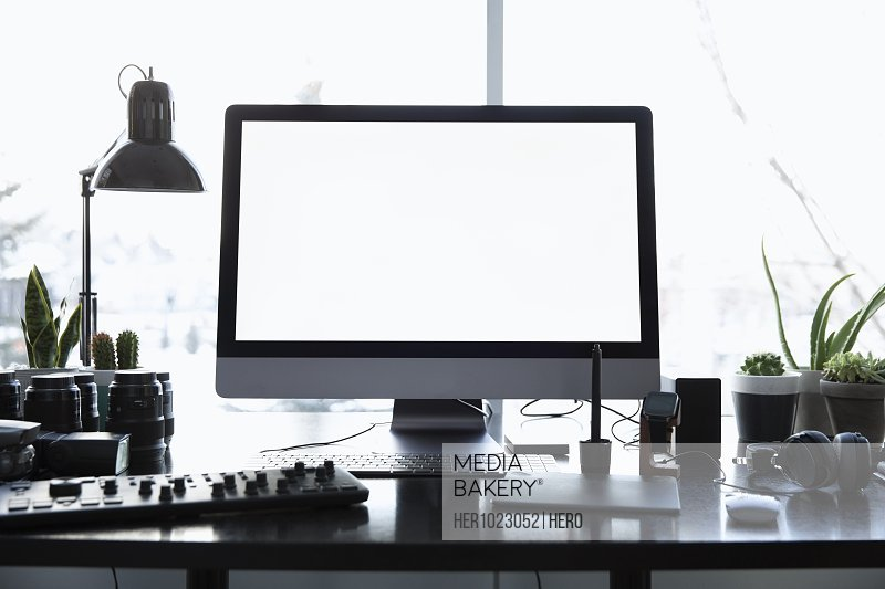 Photography equipment and computer on desk