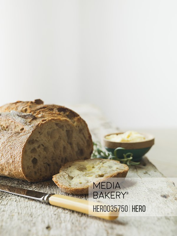 Buttered rosemary bread on counter