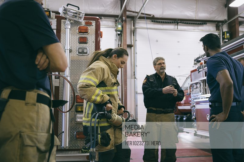 Firefighters talking in fire station