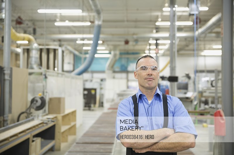 Portrait of confident manufacturing worker