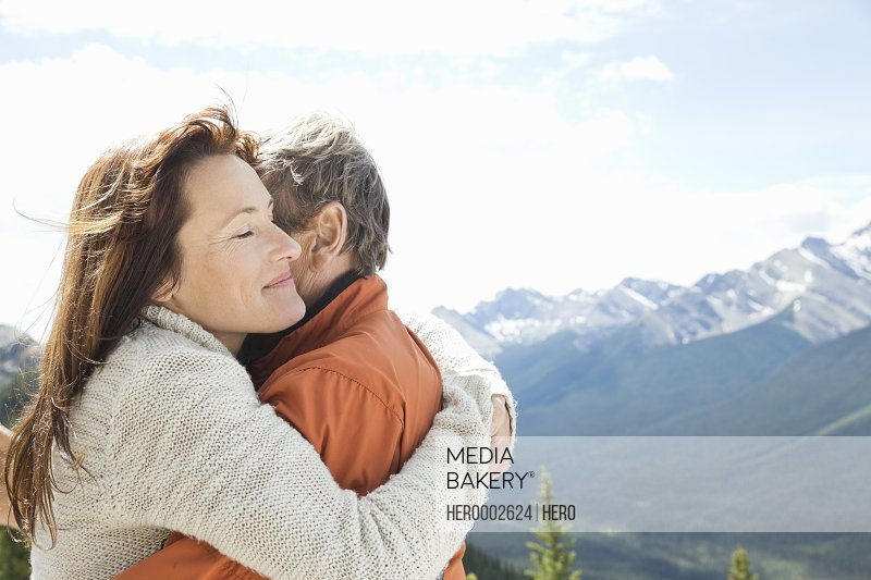 Affectionate mature couple embracing outdoors