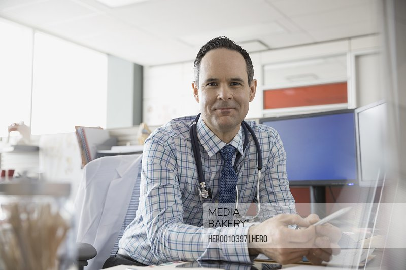 Portrait of confident doctor in office