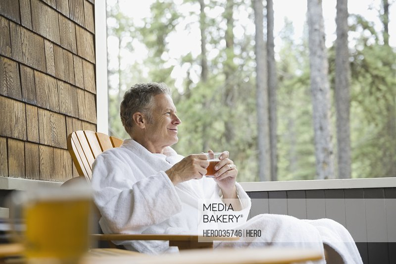 Man relaxing on porch with a cup of tea