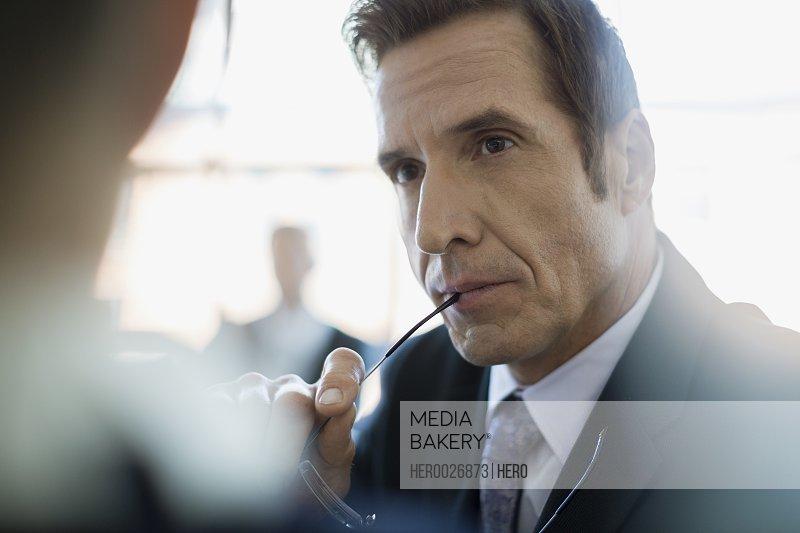Close up attentive businessman listening