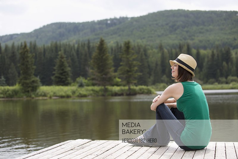 stylish mid-adult woman relaxing by the water