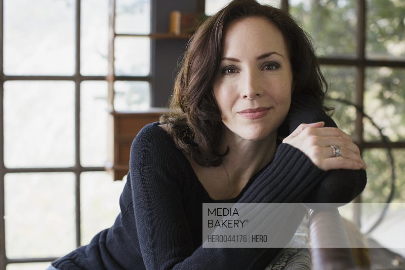 Portrait serious mature brunette woman wearing sweater