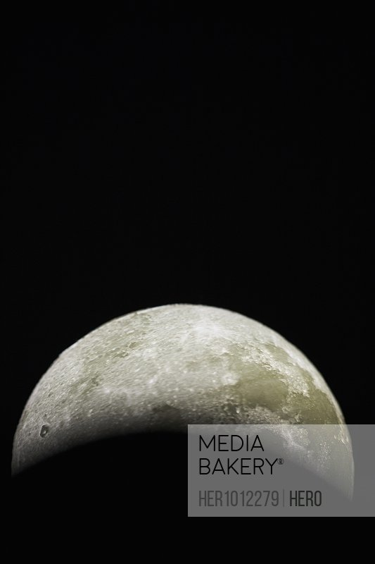 Abstract, mysterious moon on black background