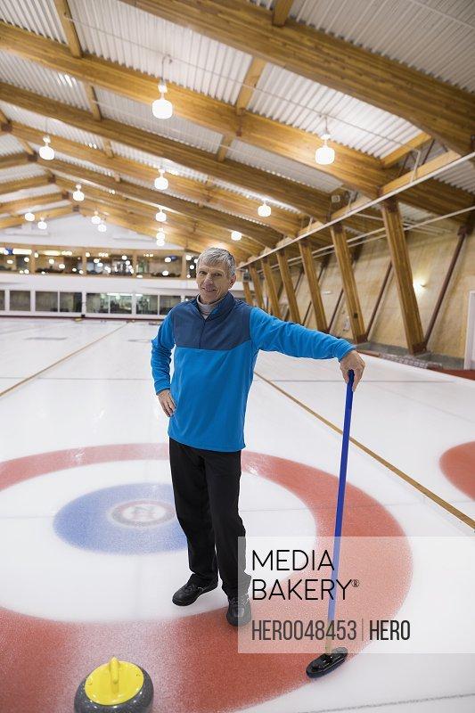 Senior man curling