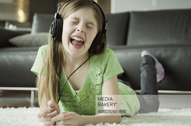 preteen listening to music