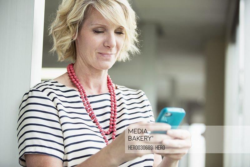 businesswoman texting on smartphone