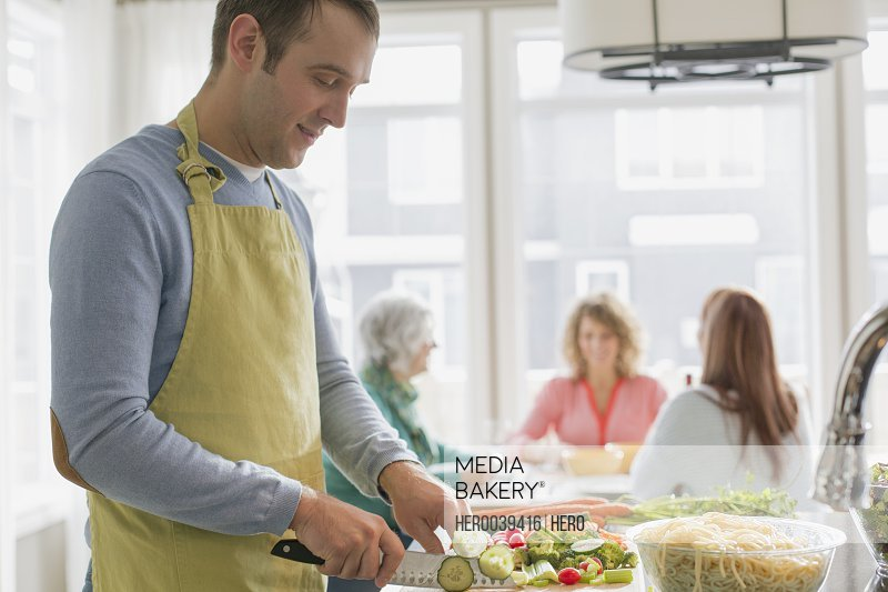 Man preparing dinner for his wife and friends