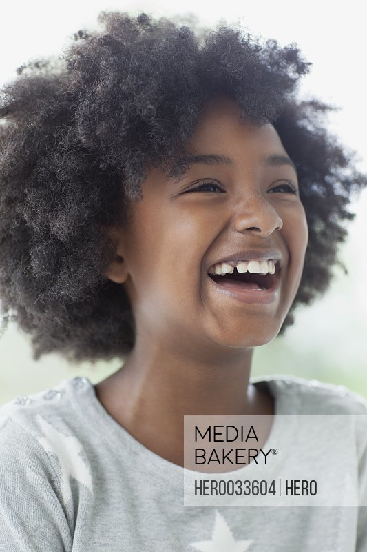 pre-teen girl with afro looking very excited