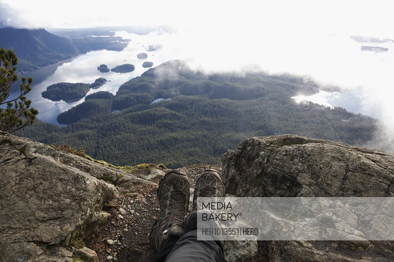 Personal perspective hiker resting, enjoying scenic view