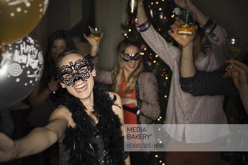 Woman in maquerade mask enjoying New Years Eve party