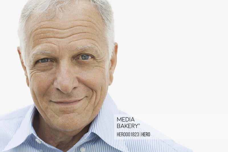 Close-up portrait of confident man against white background