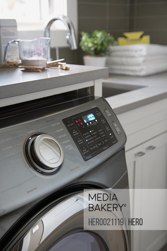 Close up energy efficient washing machine laundry room