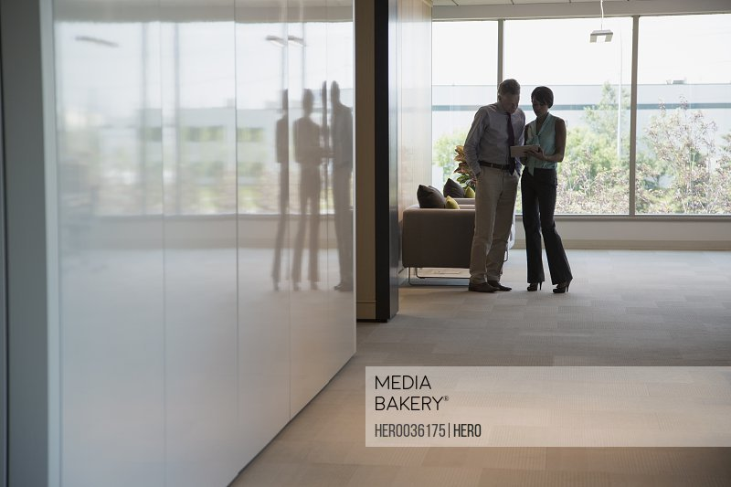 Silhouette of business people standing in office building