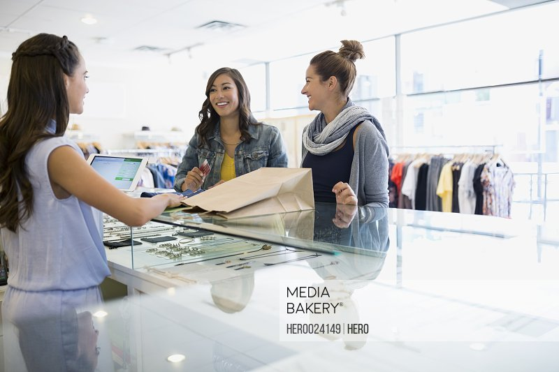 Women buying at shop counter