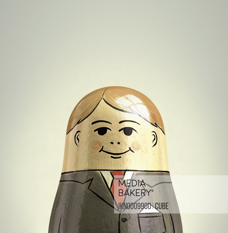 Happy smiling businessman nesting doll
