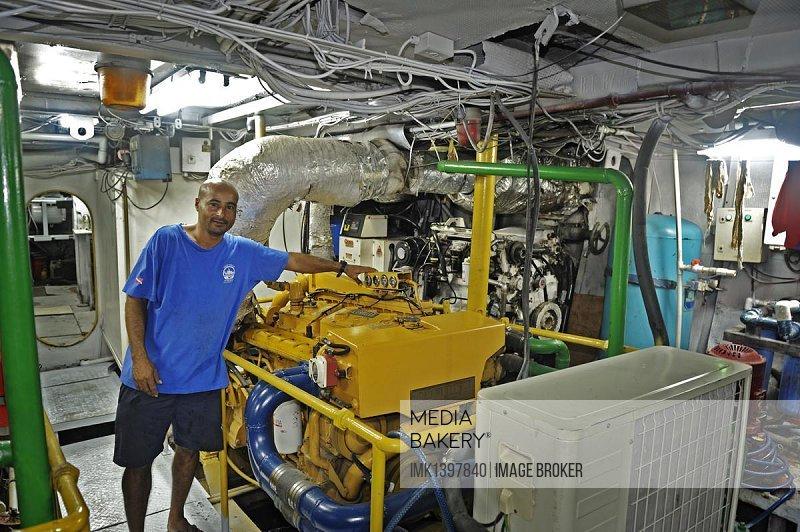 Machinist working in the engine room of a ship, Okeanoss Aggressor, Costa Rica, Central America