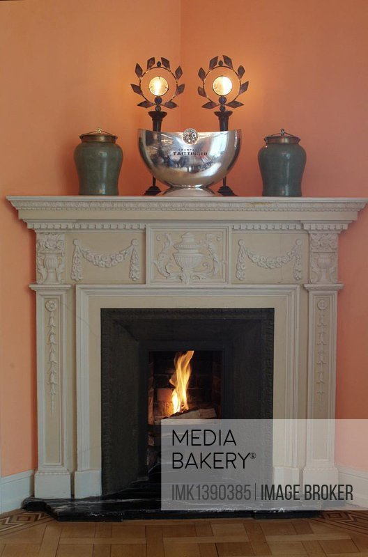 Open fireplace with a fire blazing, stylish environment