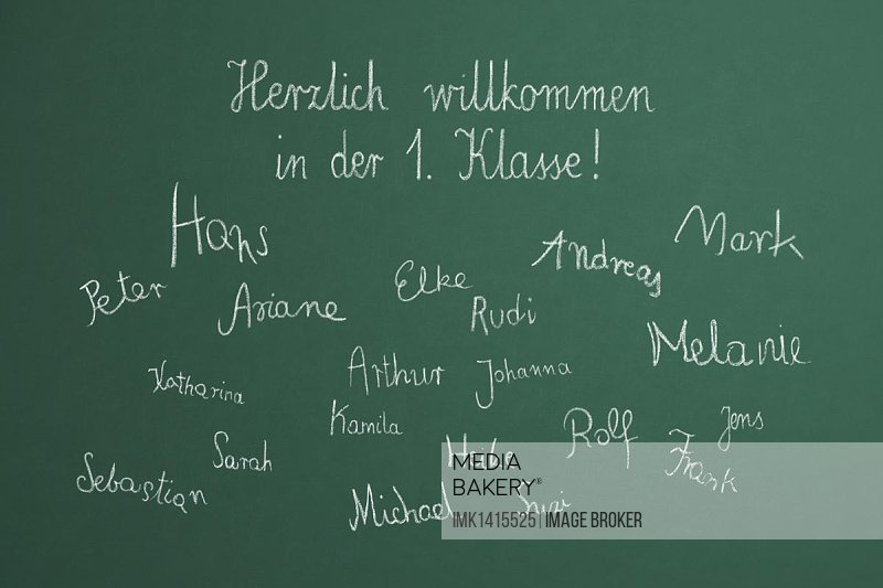 School blackboard with the message, Herzlich willkommen in der 1. Klasse, German for Welcome to 1st class, and children's names