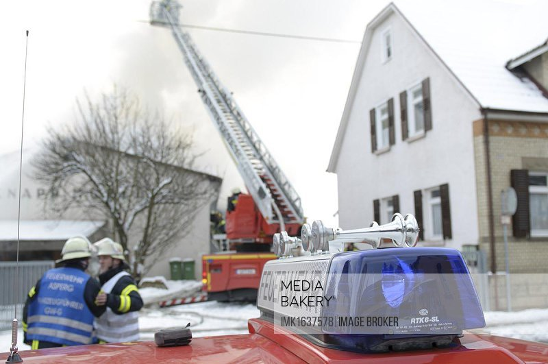 The fire department extinguishing a nearly burnt-out furniture store, Asperg, Baden-Wuerttemberg, Germany, Europe
