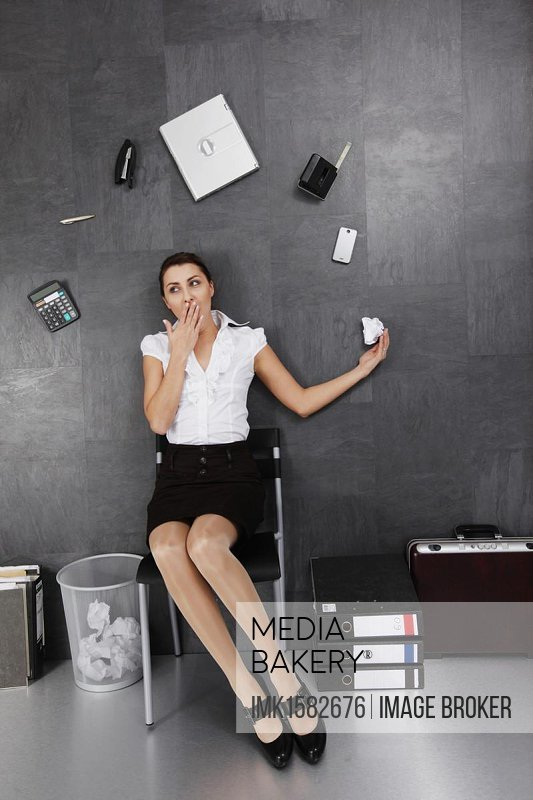 Businesswoman juggling on the floor, irritating perspective