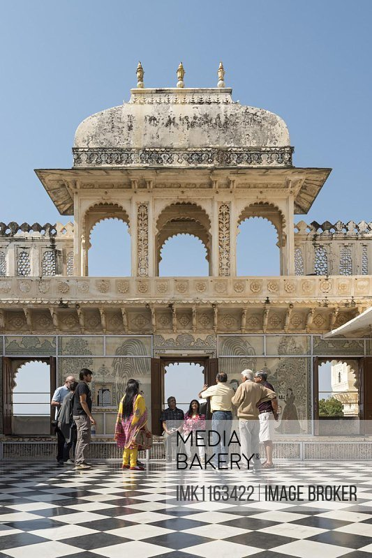 Visitors at the courtyard, City Palace, Udaipur, Rajasthan, India, Asia