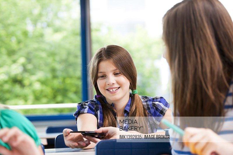 Schoolgirls communicating in the classroom