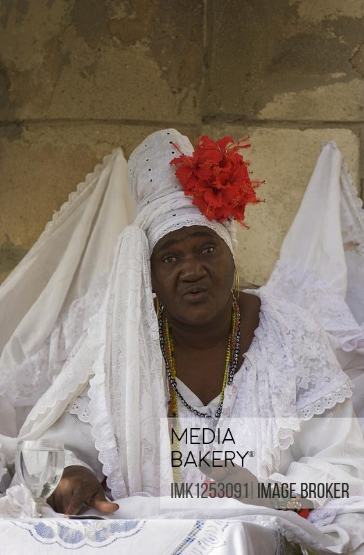Fortune teller wearing white clothes, Havana, Cuba, Central America