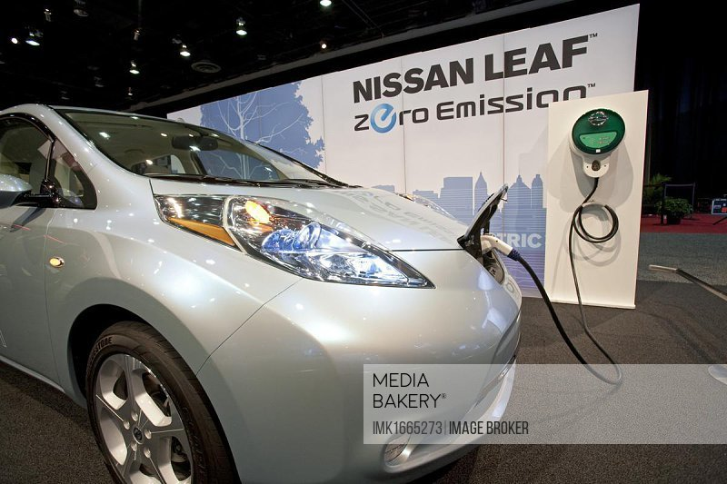 The Nissan Leaf plug-in electric car on display at the 2010 North American International Auto Show, Detroit, Michigan, USA, North America