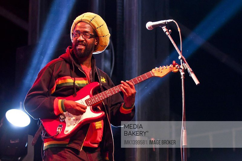 Guitarist of the Jamaican Reggae singer Max Romeo playing live at the Soundcheck open air festival in Sempach-Neuenkirch, Lucerne, Switzerland, Europe
