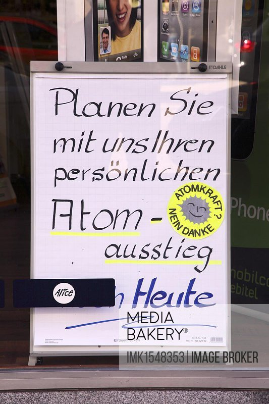 Advertising for personal phasing-out of using nuclear energy, Mobilcom Debitel shop, Essen, North Rhine-Westphalia, Germany, Europe