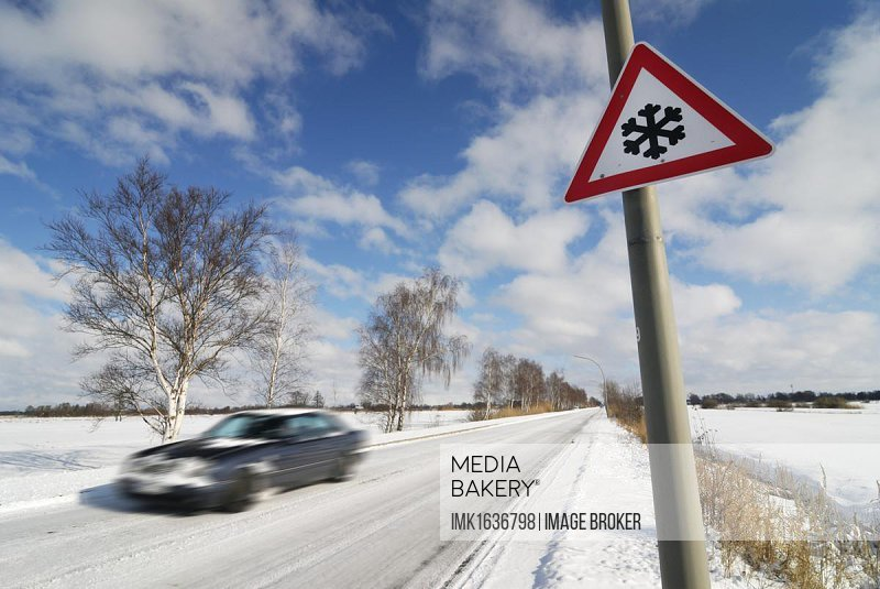 Car on snow-covered roads, slippery roads