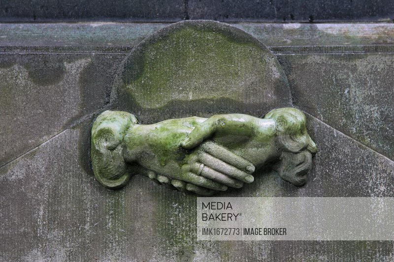 Tombstone detail, old, relief, hands clasped, shaking hands