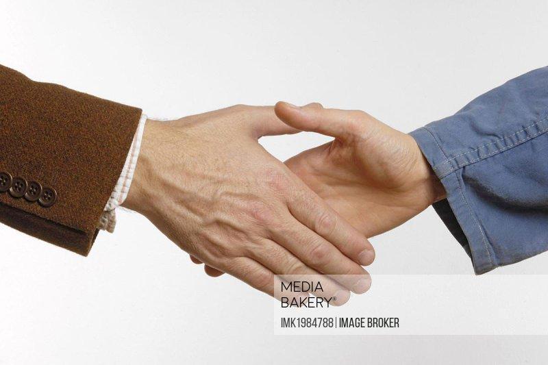 Handshake, employee - employer.