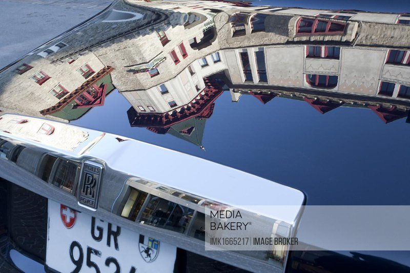 Reflection of the Palace Hotel in a Rolls-Royce, fishing boats