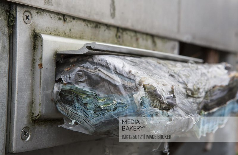 Mail rotting in a letterbox, Cologne, North Rhine-Westphalia, Germany, Europe