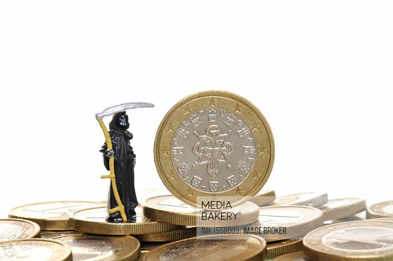 Death standing next to a Euro coin from Portugal, symbolic image for Euro crisis
