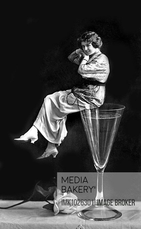Woman sitting on a champagne glass, New Year, New Year's Eve, 1920s, Germany, Europe