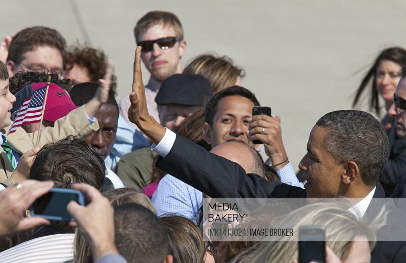 President Barack Obama greets a crowd of supporters upon arrival at Detroit Metro Airport on Air Force 1, Detroit, Michigan, USA, North America
