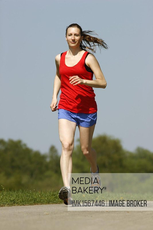 Recreational runner, young woman, 25-30 years, jogging