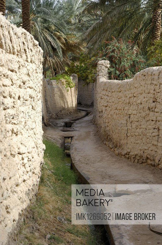 Irrigation canal in a lane, oasis city of Ghadames, UNESCO world heritage, Ghadames, Libya, Africa