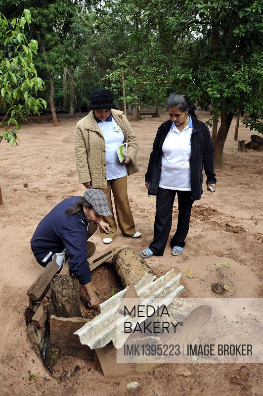 Farmer and health promoter in her garden for medicinal plants, passing on her knowledge about natural remedies to other women, Comunidad Mandu'ara, District Jasy Kany, Departamento Canindeyu, Paraguay, South America