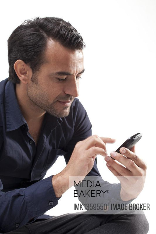 Man typing on a mobile phone