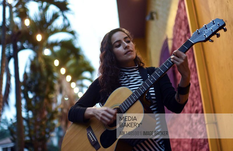 Female singer and songwriter La Lovo with guitar, Medellin, Colombia, South America