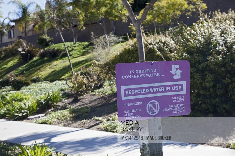 A sign warns against drinking recycled water that is used for irrigation; recycled or reclaimed water is wastewater that is treated to be safe for various uses short of drinking, Chula Vista, California, USA, North America